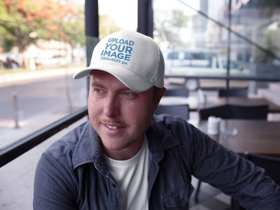 Dad Hat Mockup Being Worn by a Happy White Guy at a Restaurant a15884
