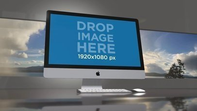 Video of an iMac Standing in an Office Room with a Landscape Image in the Back a15825