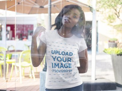 Through the Window Mockup of a Woman Wearing a Round Neck Tee 16054