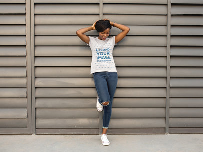 Young Black Girl Wearing a Round Neck Tee Mockup While Grabbing her Hair a16062