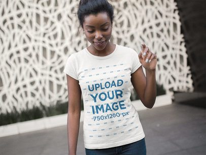 Beautiful Black Lady Wearing a Round Neck Tshirt Template While Walking a16076