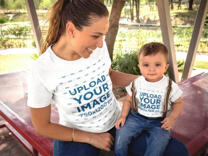 Mom and her Baby Boy Wearing T-Shirts Mockup while Outdoors 16092
