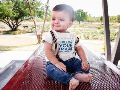 Happy Baby Boy Wearing a Round Neck Tshirt Mockup and Suspenders a16104