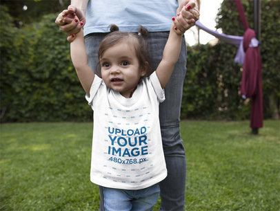 Baby Girl Walking with her Mom While Wearing a T-Shirt Mockup at Her Garden a16091