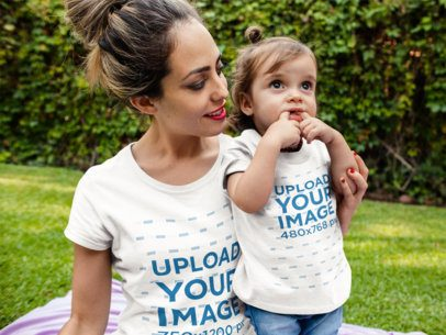 Mockup of a Mom and her Baby Girl Wearing Different Round Neck Tees Mockup While Outdoors a16075