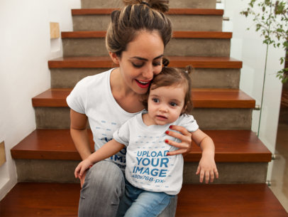 Baby Girl and Mom Wearing Different Tshirts Mockup while at Wooden Stairways 16079
