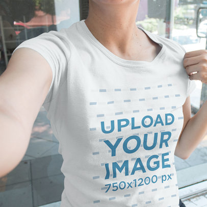Selfie Mockup of a Cropped Face Customer Wearing a Round Neck T-Shirt a16212