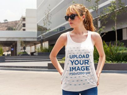Pretty Girl Wearing a Bella Canvas Tank Top Mockup While in the City a16121