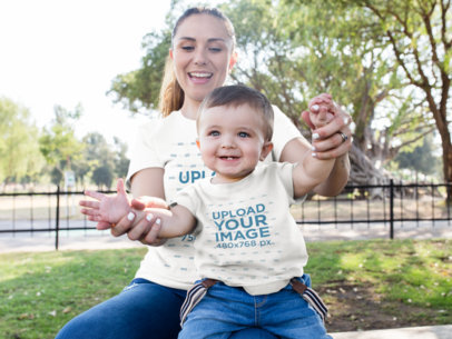 Mom and Her Baby Boy Playing in the Park While Wearing Different Round Neck Tees Mockup 16100