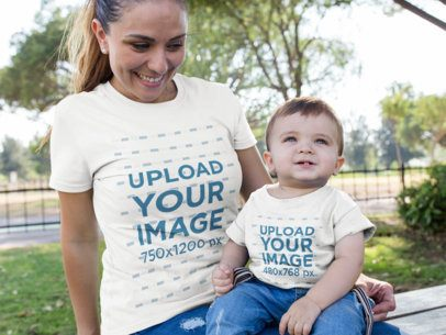 Mockup of a Woman with her Baby Boy Wearing Different T-shirts While at the Park 16101