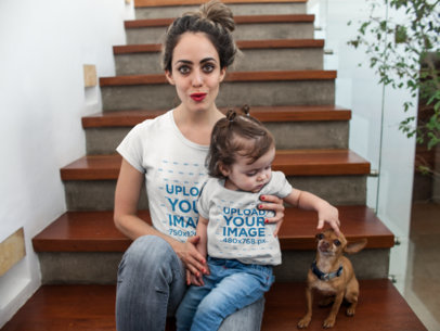 Pretty Mom and Her Baby Girl Wearing Different T-Shirts Mockup While in Wooden Stairways with a Dog 16087