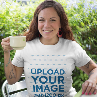 Mockup of a Happy Middle Aged Woman Wearing a T-Shirt While Having a Coffee in the Backyard a16192