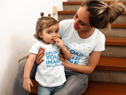 Little Girl Eating a Cookie While with her Mom Wearing T-Shirts Mockup a16094