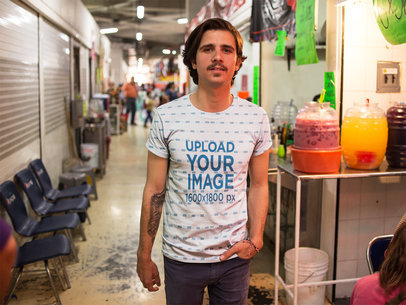 Young White Dude Walking in a Traditional Market While Wearing a Round Neck Sublimated Tee Template a15357