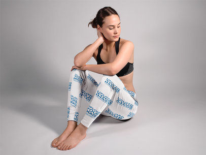Beautiful Woman Sitting Down in a Studio While Wearing Sweatpants Mockup a15588