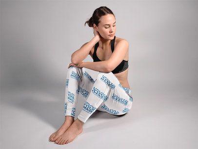 Beautiful Woman Sitting Down in a Studio While Wearing Sweatpants Mockup a15588