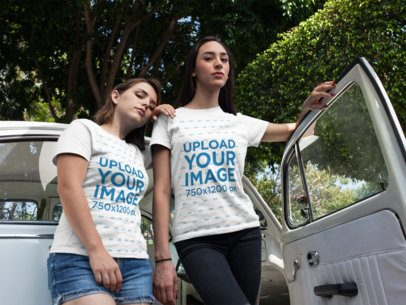 Girls Wearing Tshirts Mockup While Standing Near a Vintage Car with Open Door a16247
