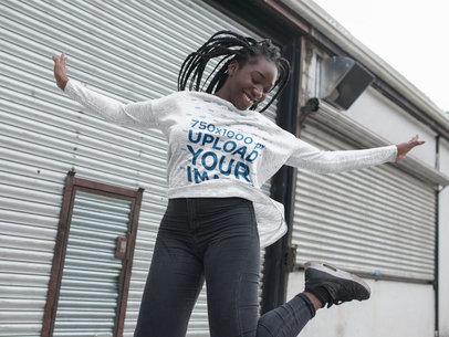 Jumping Girl with Dreadlocks Wearing a Heather Long Sleeve Tee Mockup Outdoors a16211