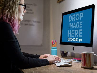 Girl Working in an iMac While Wearing Glasses at the Office a16260