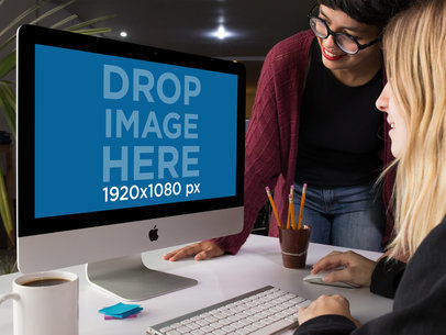 Pair of Women Using an iMac Template While at the Office a16262