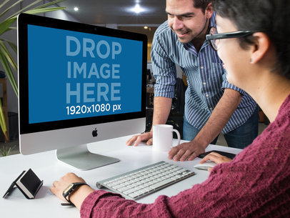 Man and Woman Working at the Office with an iMac Template a16265