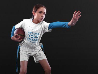 Custom Football Jerseys - Little Angry Girl Holding the Ball Inside the Studio a16532
