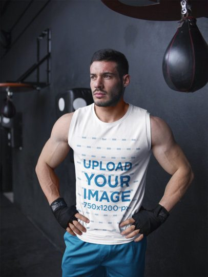 Mockup of a Muscular Man Wearing Custom Sportswear While Near the Boxing Speed Bag a16799