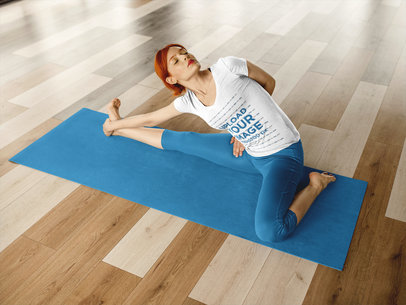 Mockup of a Redhead Girl Doing a Yoga Pose While Wearing Custom Sportswear a16827