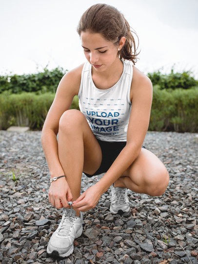 Teen Girl Tying her Laces While Wearing Custom Sportswear Mockup a16861