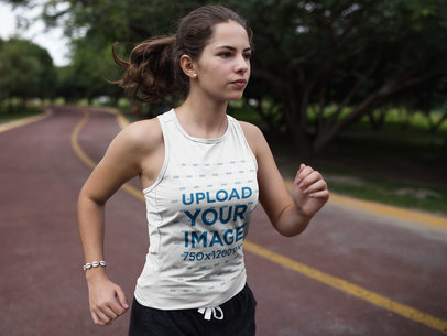 Woman Running at a Running Track while Wearing Custom Sportswear Mockup a16860