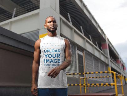 Portrait of a Black Man Wearing Custom Sportswear Mockup in an Industrial Area a16880