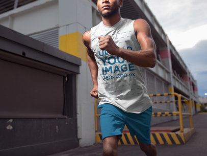 Closeup of a Black Man Running While Wearing Custom Sportswear Mockup at an Industrial Area a16878