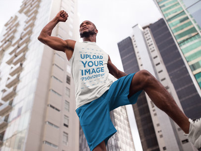 Black Man Jumping in the City While Wearing Custom Sportswear Mockup a16871