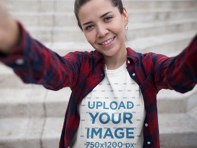 Selfie of a Girl Wearing a T-Shirt Mockup Outside her School a16909