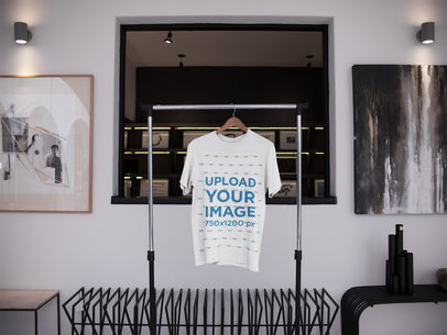 T-Shirt on a Rack Mockup While Inside an Artists Room a16949