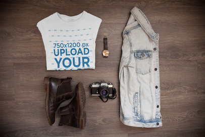 Folded T-Shirt Mockup Alongside a Denim Jacket and Accessories a16957