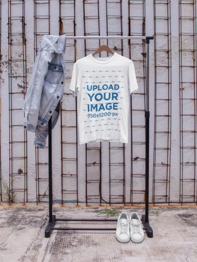 T-Shirt Mockup on a Hanger Against a White Wall a16952
