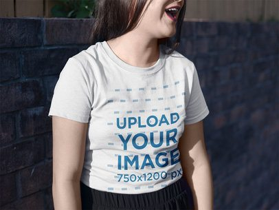 Mockup of a Girl Laughing While Wearing a Round Neck Tee Outdoors a16960