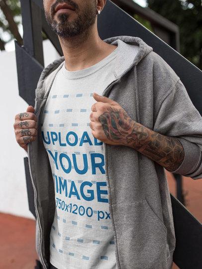 Close Up of a Tattooed Man Wearing a T-Shirt Mockup and a Sweatshirt a16985