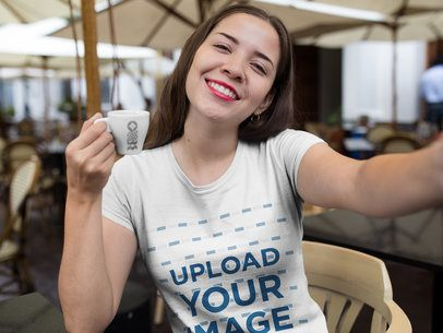 Selfie Mockup of a Smiling Girl Wearing a T-Shirt While Drinking a Coffee a16919