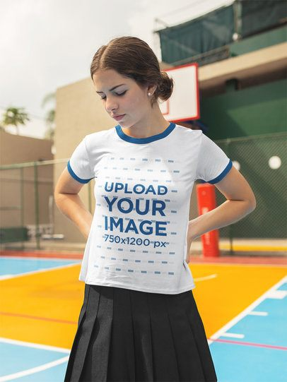Beautiful Teenager Wearing a Ringer Tshirt Mockup While Looking Down a17057