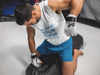Mockup of a Man Practicing MMA with a Punching Bag While Wearing Custom Sportswear a17034