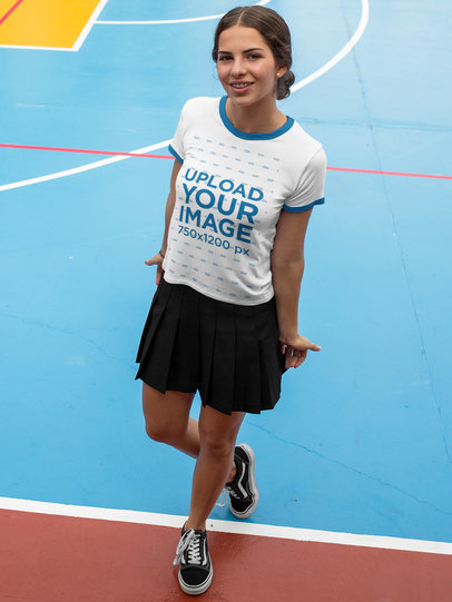 Smiling Girl Wearing a Ringer Round Neck Tee Template While at a Colorful Court a17059