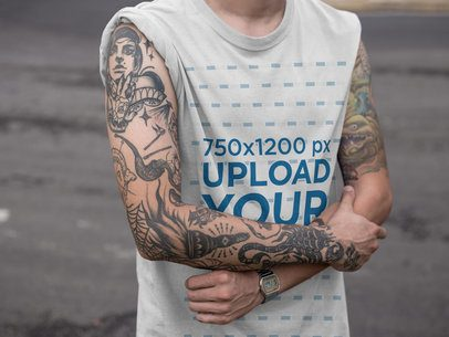 Mockup of a Tattooed Man Wearing a Round Neck Tee with Rolled Up Sleeves a17074