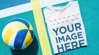 Volleyball Jersey Maker - Folded Jersey Lying Near a Volleyball a16929