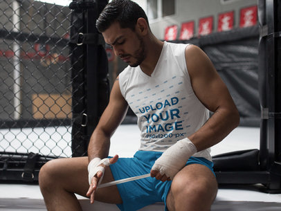 MMA Student Wearing Custom Sportswear Mockup While Wrapping his Hands a17039