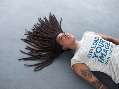 Hispanic Girl with Dreadlocks Lying on a Concrete Floor a17137