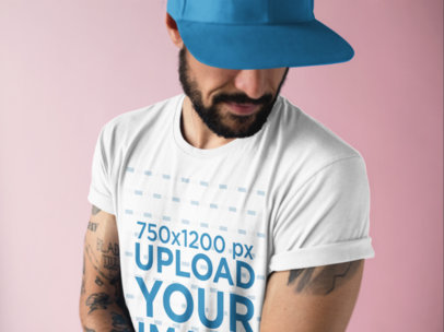Closeup of a Tattooed Man Wearing a Round Neck Tee Mockup at a Studio a17016