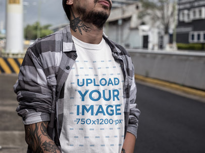 Cropped Face Urban Man Wearing a Round Neck Tee Mockup While at the Street a17072