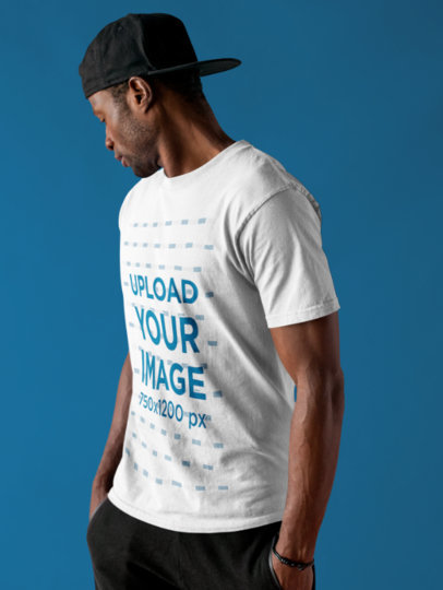Black Dude Wearing a Round Neck Tee Mockup While Against a Solid Backdrop a17154